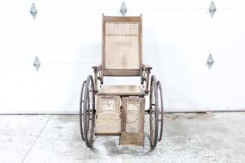Medical, Wheelchair, OLD STYLE/ANTIQUE WHEELCHAIR, CANING SEAT & BACK, WOOD LEG RESTS & ARMS, 2 LARGE METAL WHEELS & 1 SMALL BACK WHEEL, NON-COLLAPSIBLE , WOOD, BROWN