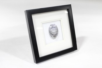 "Wall Dec, Shadow Box, SINGLE POLICE/COP BADGE, ""POLICE OFFICER PATROLMAN, STATE OF CALIFORNIA,"" WHITE MATTE, PLAIN BLACK FRAME, METAL, SILVER"
