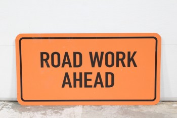 "Sign, Construction, ""ROAD WORK AHEAD"", BLACK TEXT & BORDER (ONE SIDED), LIGHTWEIGHT PLASTIC, AGED, PLASTIC, ORANGE"