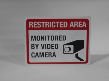 Sign, Prohibit, RESTRICTED AREA MONITORED BY VIDEO CAMERA, WHITE BACKGROUND, WHITE AND BLACK TEXT, METAL, WHITE