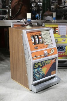 "Game, Casino , 25c SLOT MACHINE, SIDE PULL LEVER W/BLACK BALL END, BROWN LAMINATE SIDES, ""SPUTNIK"" GRAPHIC PANEL, TOP LIGHT , METAL, BROWN"