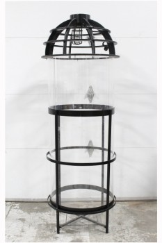 "Industrial, Miscellaneous, FREESTANDING PLEXI CYLINDER CHAMBER, BLACK METAL FRAME HOLDS BOTTOMLESS CYLINDER, 62"" TO TOP OF PLEXI, VENTED TOP W/CAGED LIGHT HAS METAL LOOK & IS REMOVEABLE, LIGHT WORKS (06/2019), PLEXIGLASS, CLEAR"